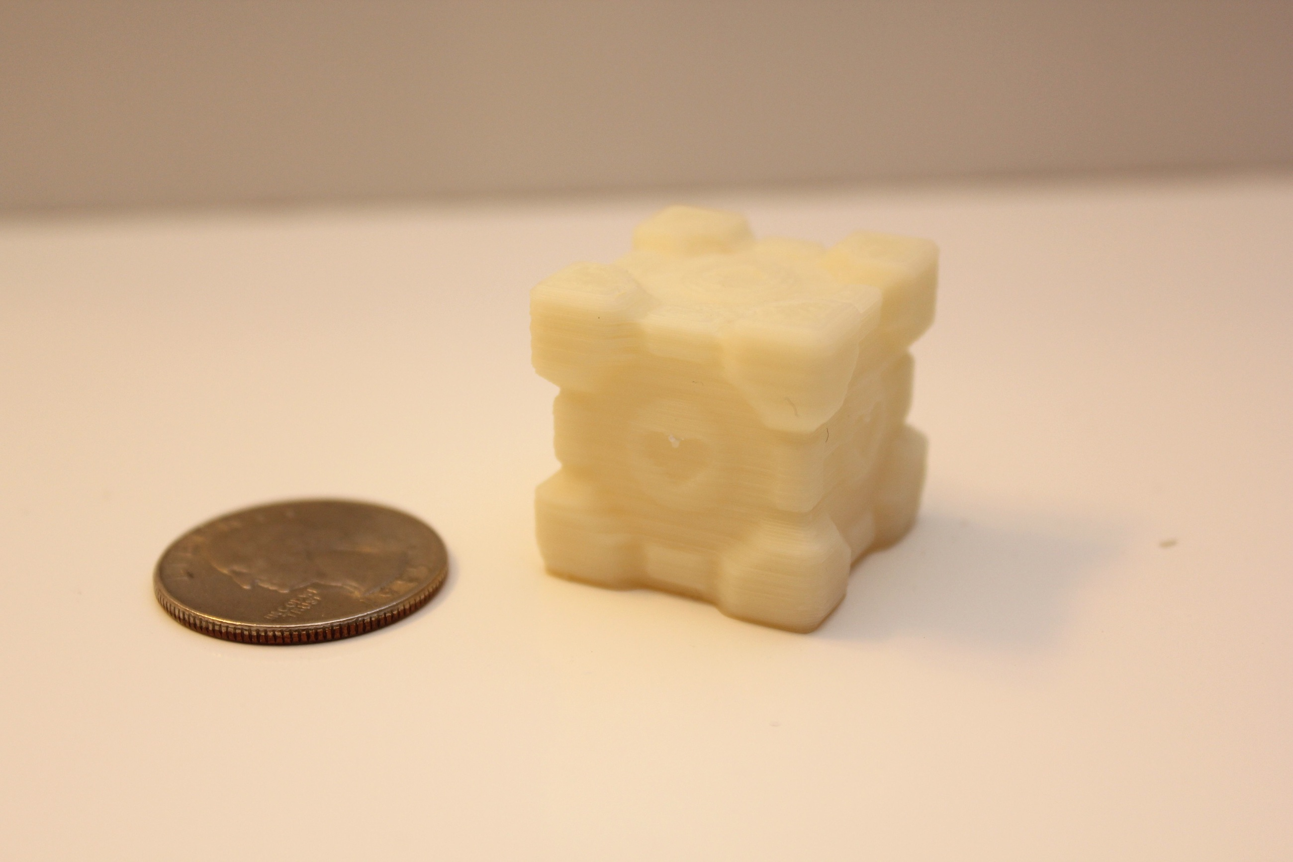 Companion Cube and a quarter for comparison printed on PrintrBot Plus